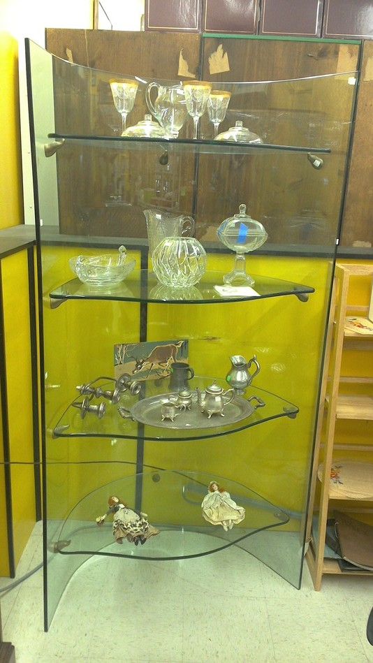 Curved glass shelving display