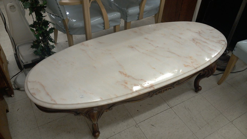 marble top coffee table with ornately carved wood base