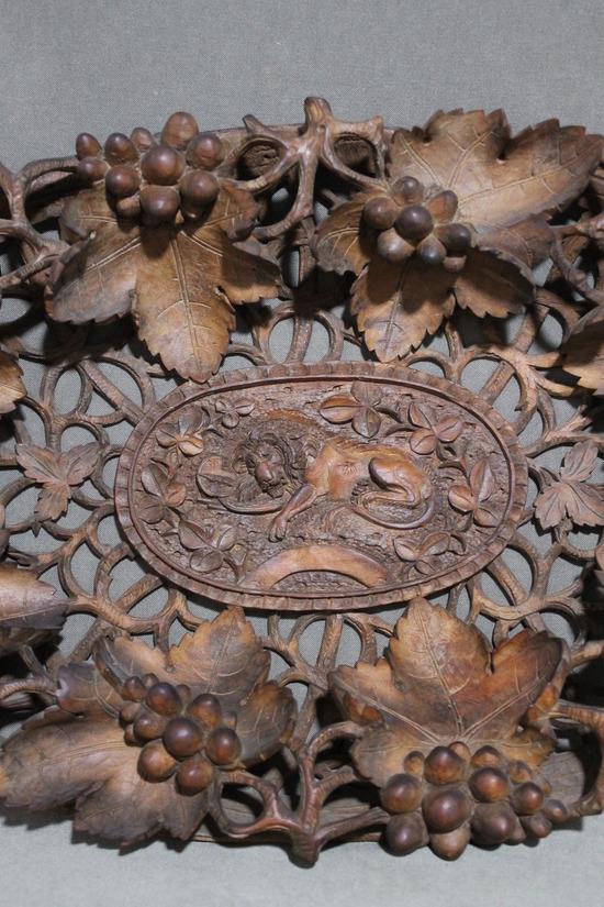 Large antique piece black forest carved wood grape vine