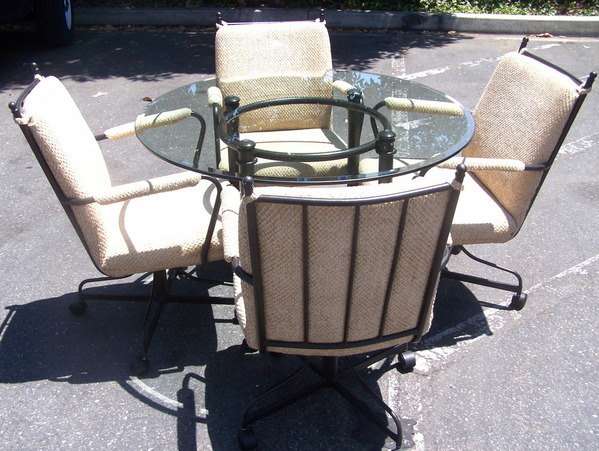 dining set round glass and metal table and four rolling