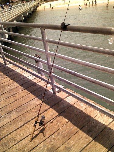Pier or dock fishing rail rod pole holder for spinning or for Pier fishing rod holder
