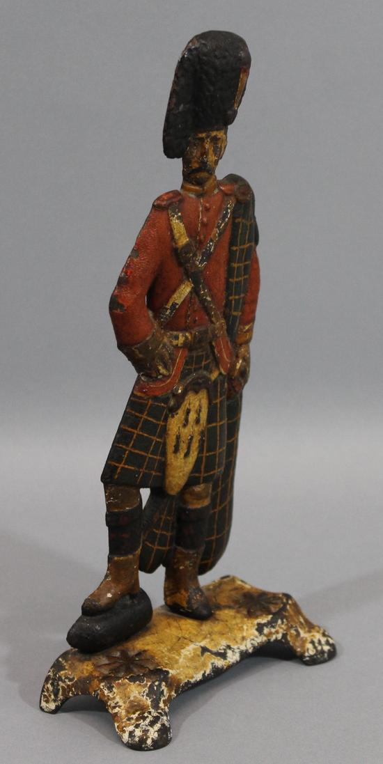 Rare antique painted cast iron scottish highlander soldier for Valuable antiques and collectibles
