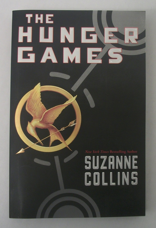 Low Use The Hunger Games by Suzanne Collins Trade Paperback - Scholastic