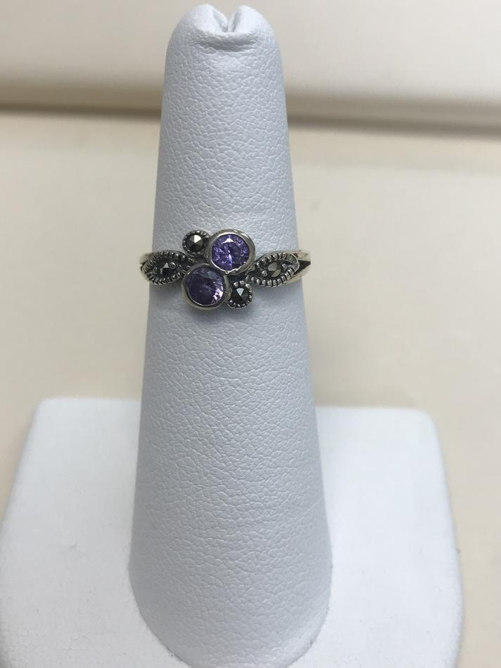 STERLING SILVER RING .925 WITH PURPLE STONES SIZE 5.5