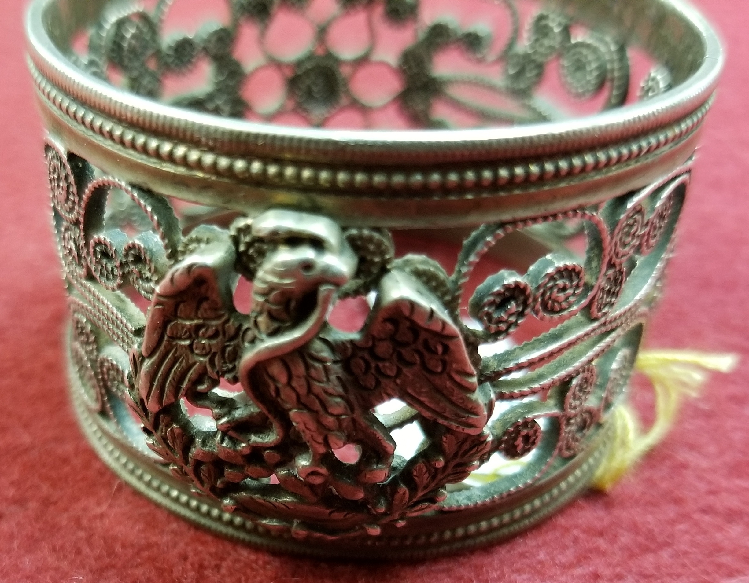 COLLECTIBLES: SILVER NAPKIN RING  EAGLE W/ SNAKE IN MOUTH & PAISLEY TYPE DESIGN