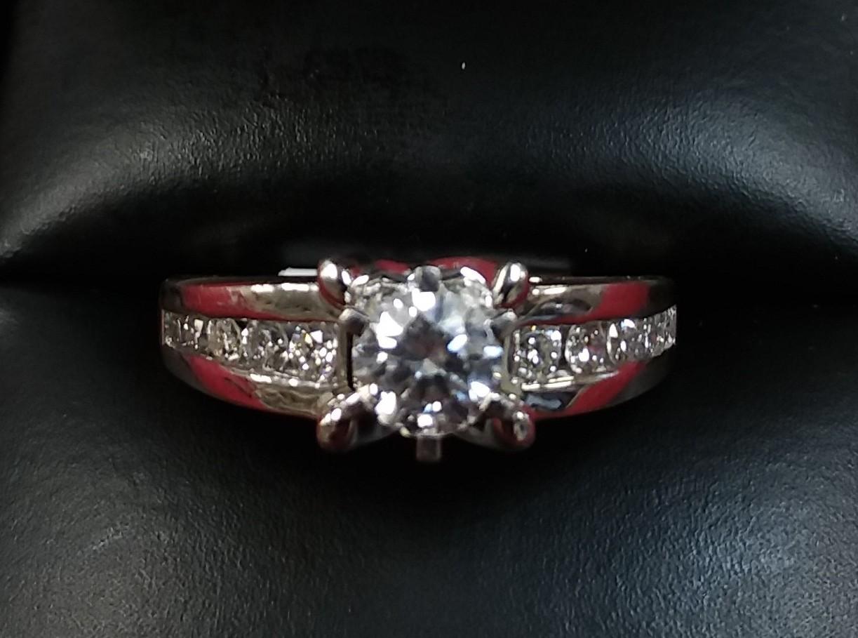 SIZE 6.5 14KT WHITE GOLD  DIAMOND RING.