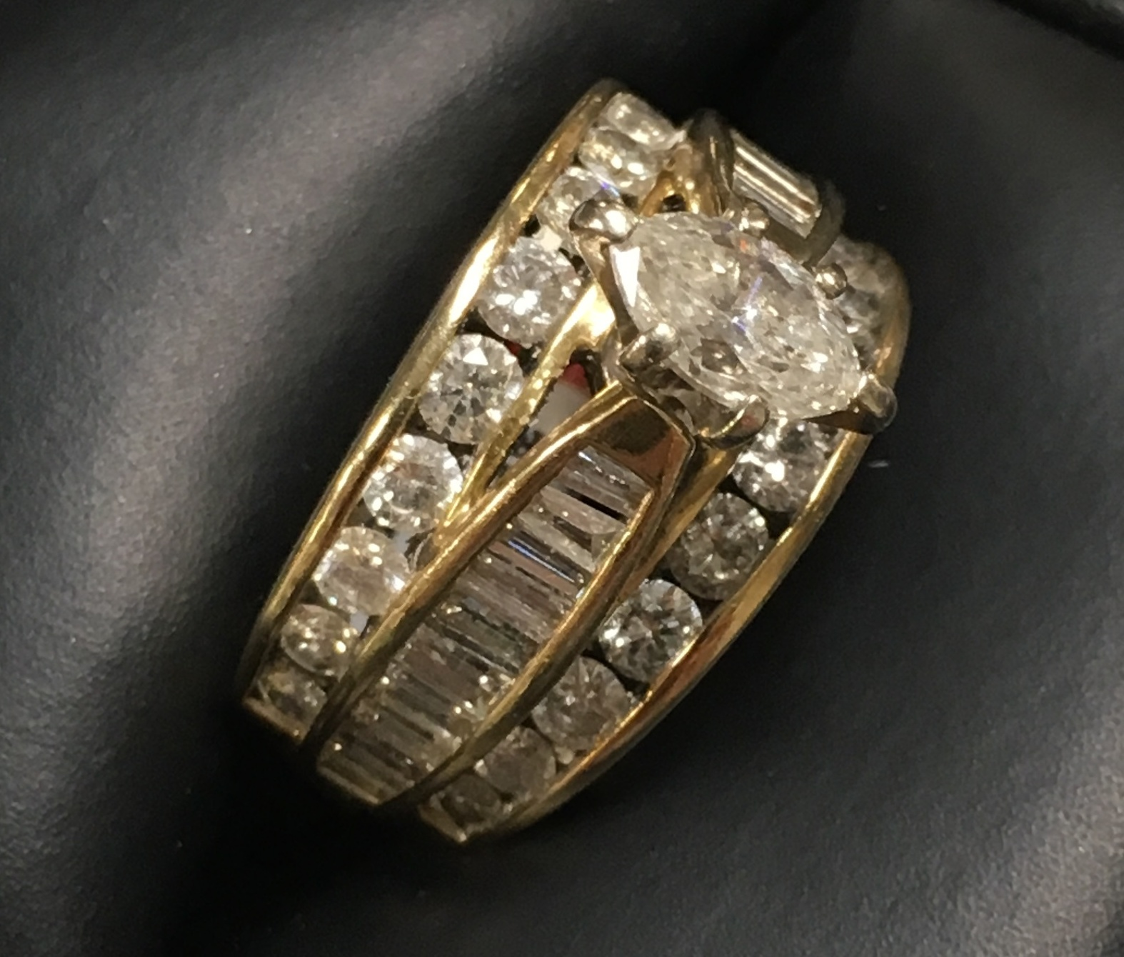 14KT YELLOW GOLD APPROX .45 MARQUISE DIAMOND RING. SIZE: 7
