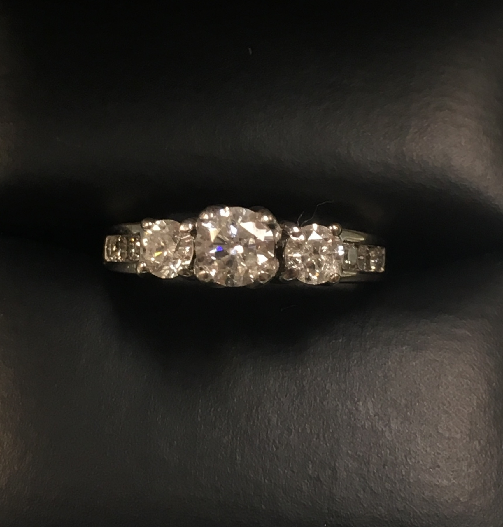 14KT WHITE GOLD APPROX 1/3 DIAMOND RING. SIZE: 5.5