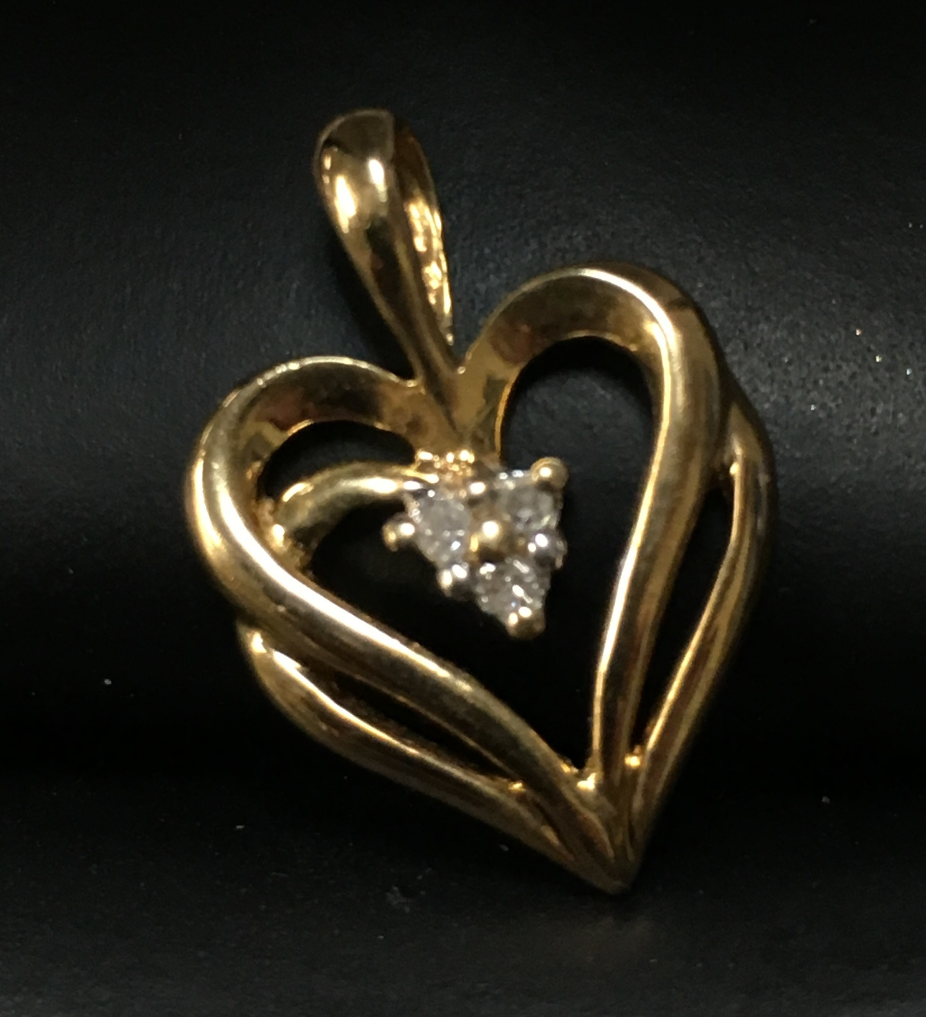 10KT YELLOW GOLD HEART CHARM WITH 3 TINY CLEAR STONES