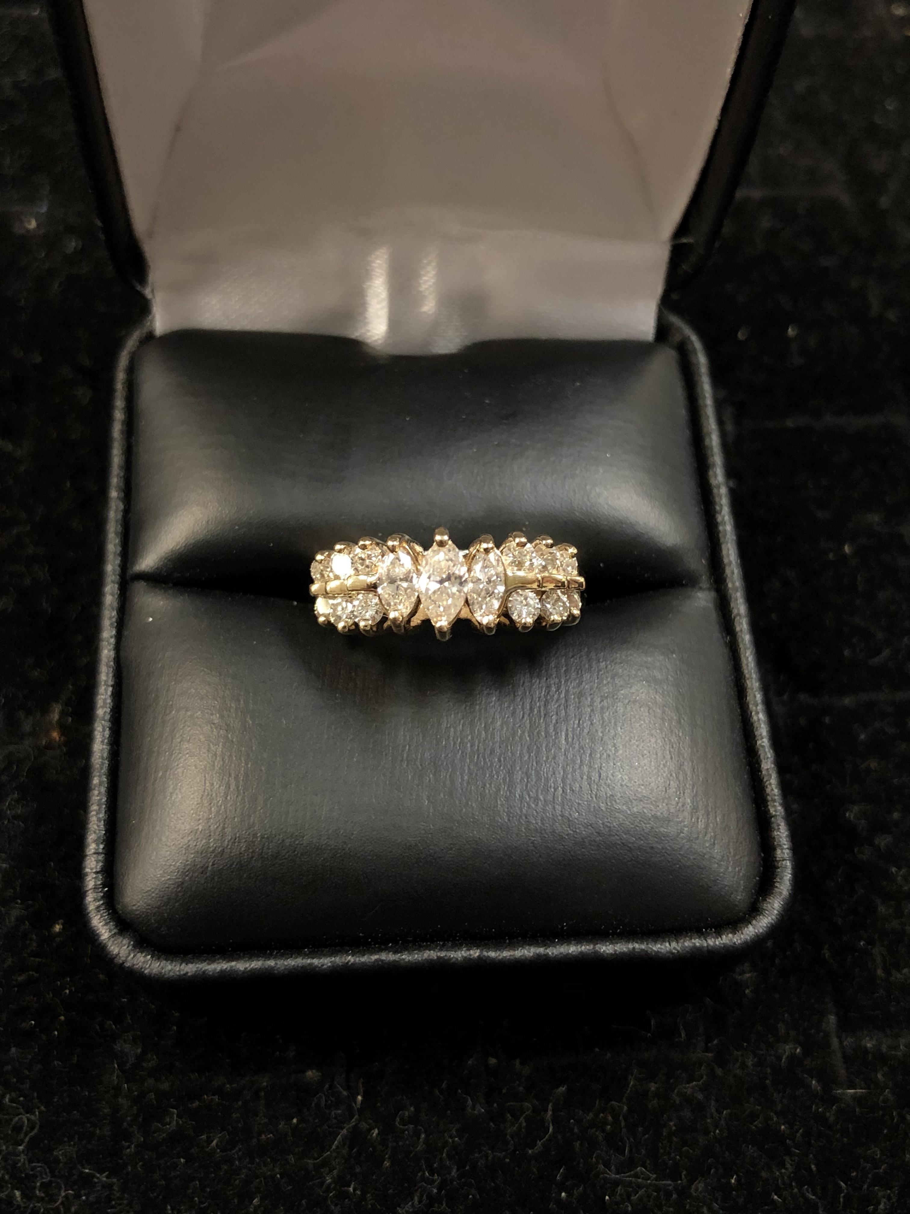 14 KT YELLOW GOLD 1/4 CT MARQUISE DIAMOND IN CENTER W/ SURROUNDING DIAMONDS