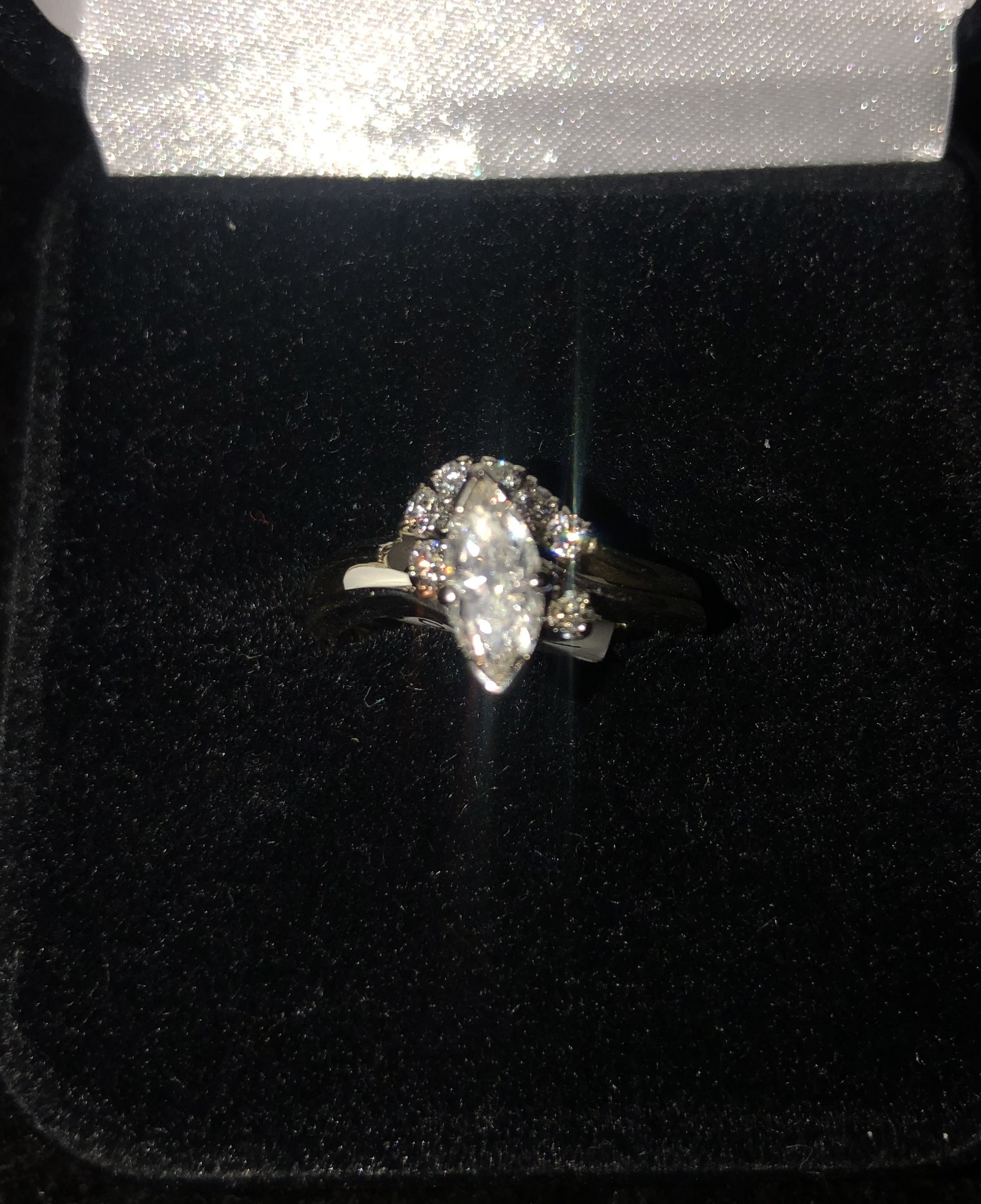 14KT WHITE GOLD APPROX .63 MARQUISE DIAMOND W/ A 5 DIAMOND INLAY WRAPPED BAND