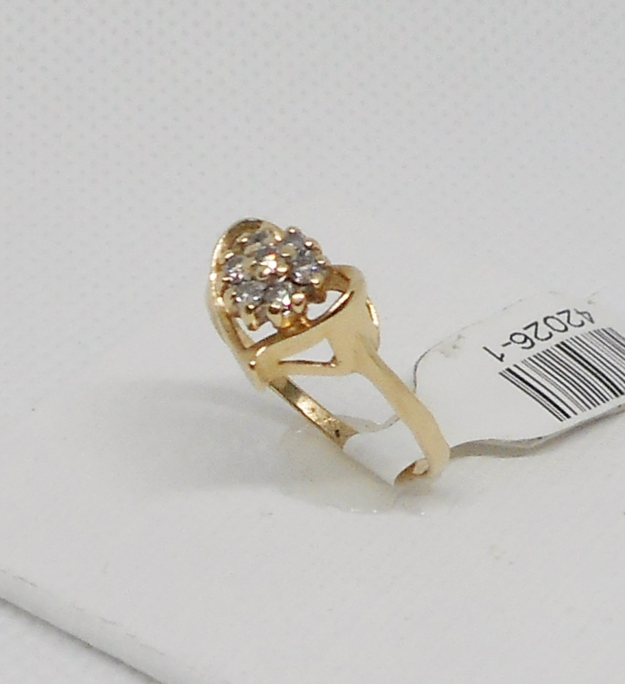 HEART SHAPED RING WITH FLOWER SHAPED DIAMOND CLUSTER
