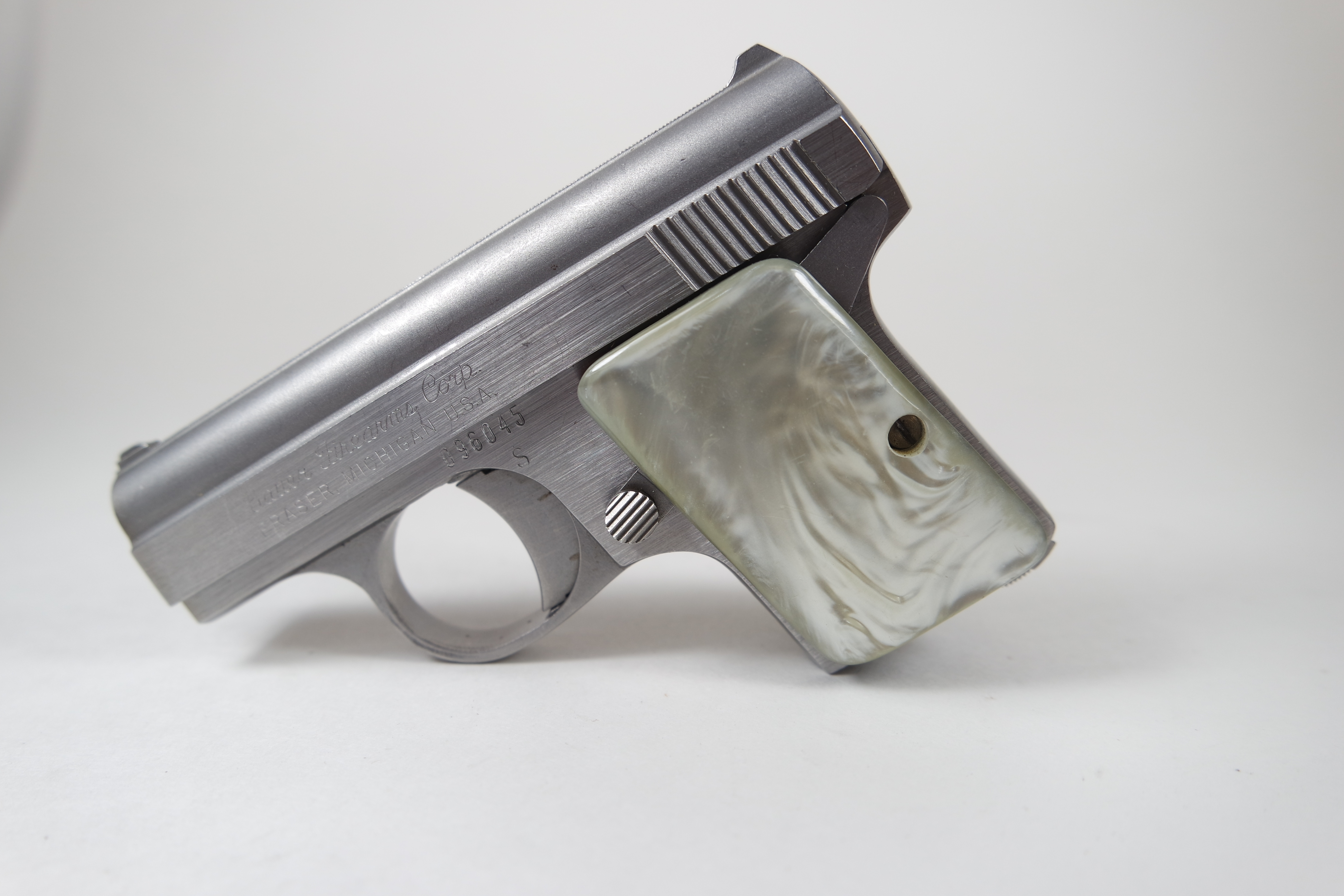 Bauer Automatic .25 stainless steel pistol pearlescent grips Pre-owned