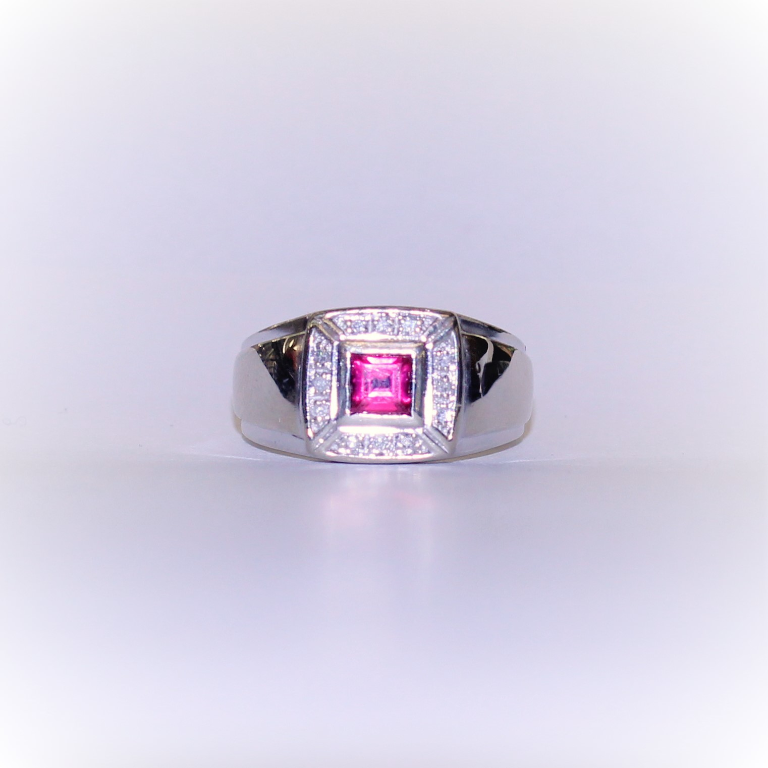 MEN'S RED STONE 10KT DIAMOND RING