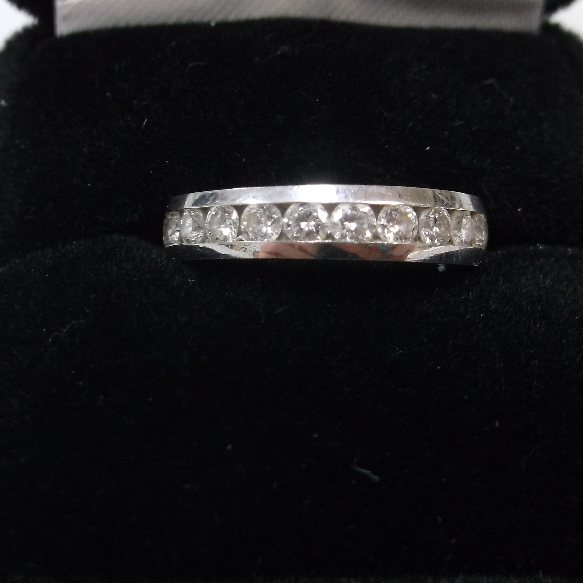 14 KT WHITE GOLD BAND WITH DIAMONDS
