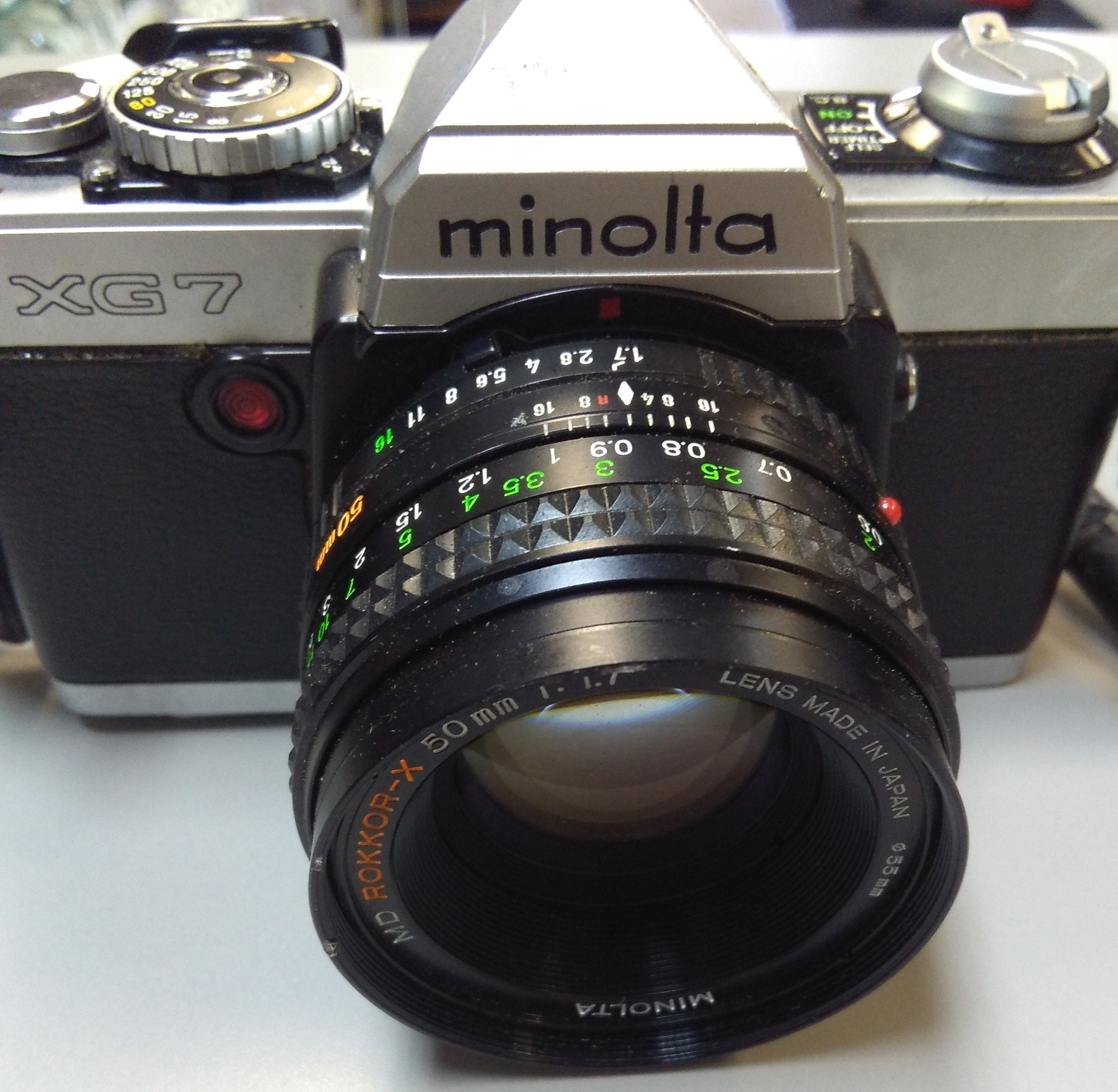 Minolta XG7 35 mm camera with strap