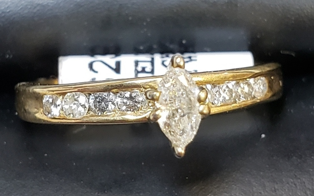 14KT - YELLOW GOLD - SIZE 5.5 - APPROXIMATELY 1/8 MARQUE CUT DIAMOND RING