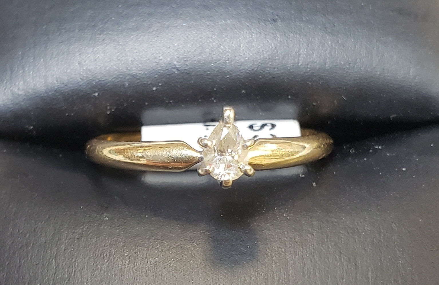 14KT - YELLOW GOLD - SIZE 7 - APPROXIMATELY 1/4 PEAR CUT SOLITAIRE DIAMOND RING