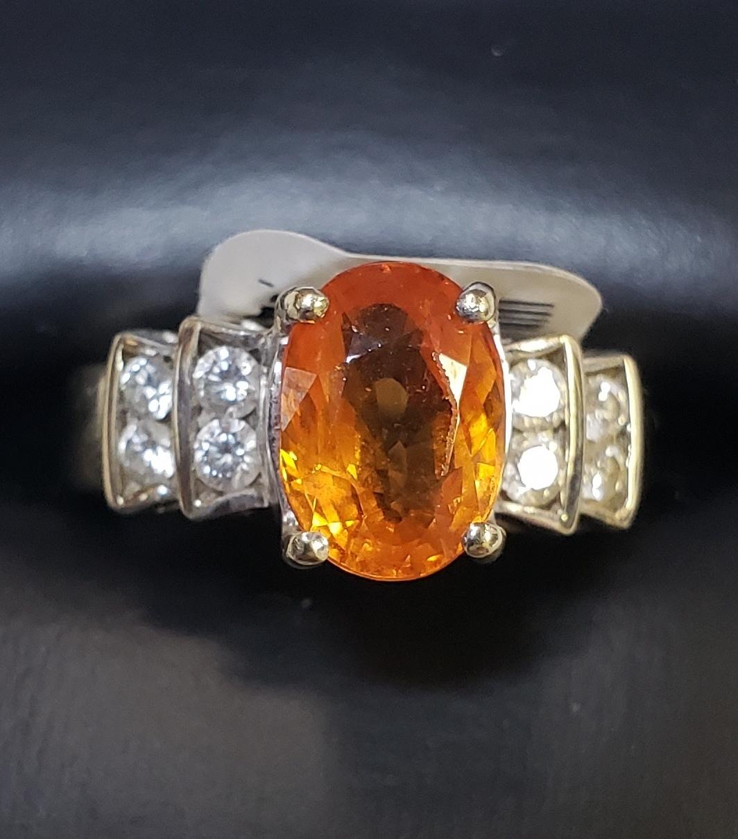 18KT - YELLOW GOLD - OVAL SPESSARTITE GARNET & APP. 3/8 CT TW DIAMOND RING