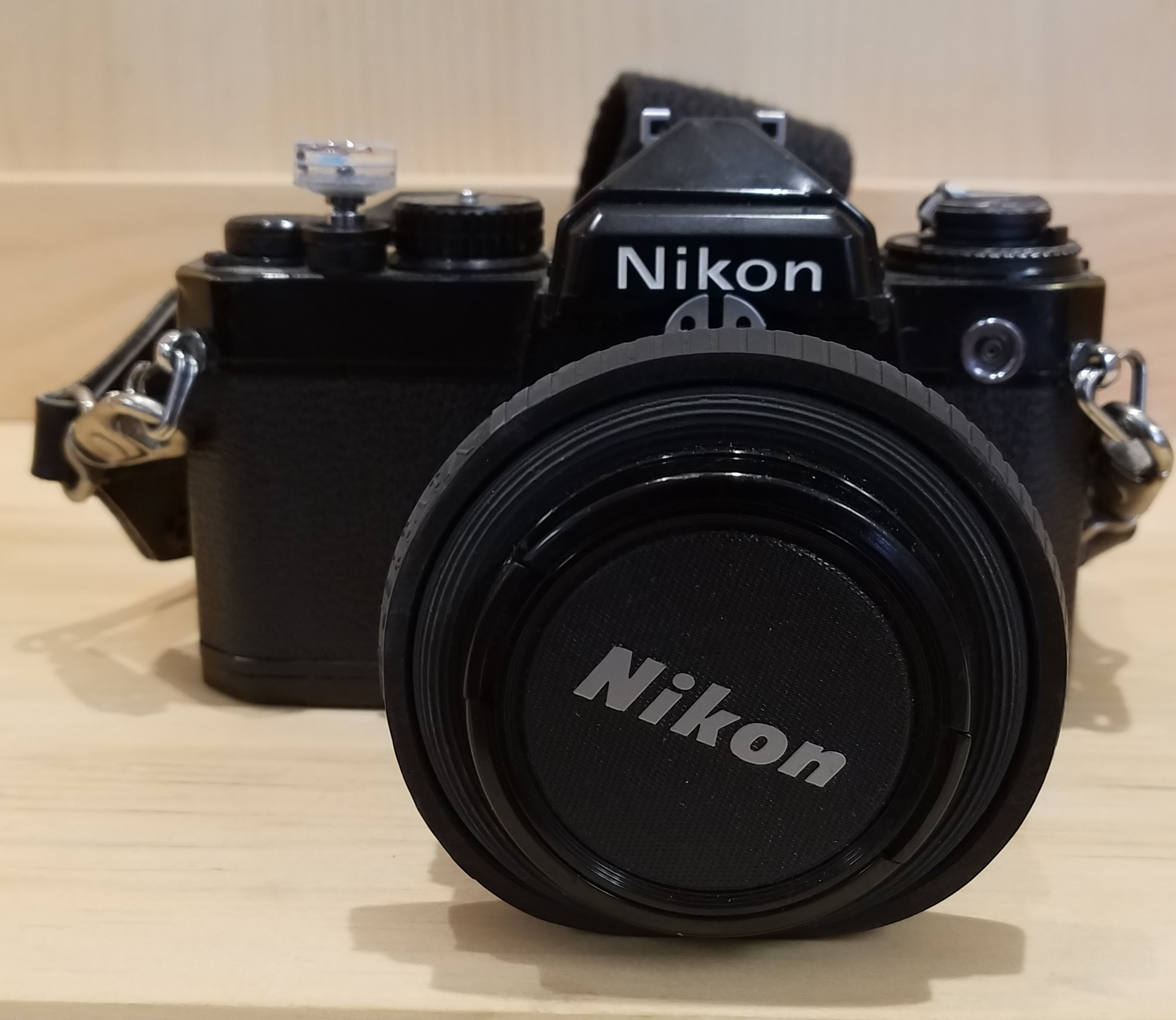 NIKON  35MM CAMERA WITH CASE AND STRAP