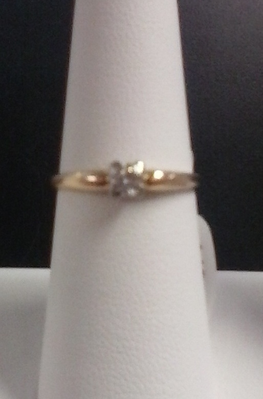 SIZE 6.5 LADIES ENGAGEMENT RING WITH .15K ROUND DIAMOND IN CENTER